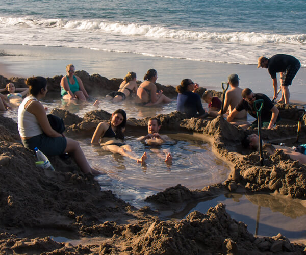 Hot water beach is a beach with close to the surface hot natural volcanic springs that allow people to dig holes and soak in thermal waters